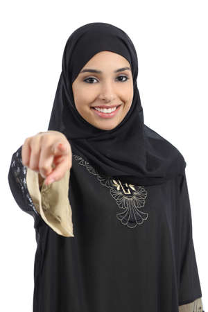 Saudi arab woman pointing at you and looking at camera isolated on a white background                photo