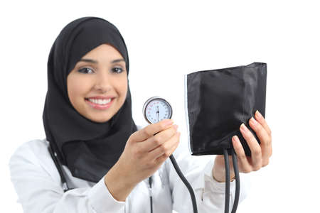 controling: Saudi arab woman showing a sphygmomanometer isolated on a white background