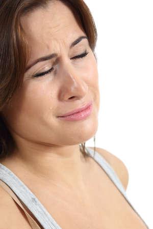 mujer llorando: Retrato de una mujer llorando con lágrimas aislado en un fondo blanco Foto de archivo