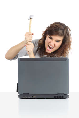 angry computer: Angry woman ready to destroy a computer with a hammer isolated on a white background
