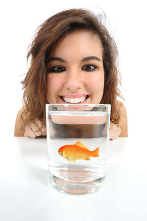Pet fish in a glass needs care and a woman looking it isolated on a white background            photo