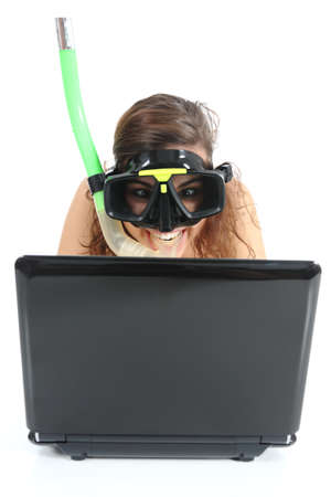Snorkel woman websurfing in a netbook computer isolated on a white background