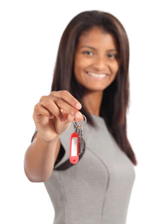 Beautiful african american businesswoman giving a home keys isolated on a white background      photo