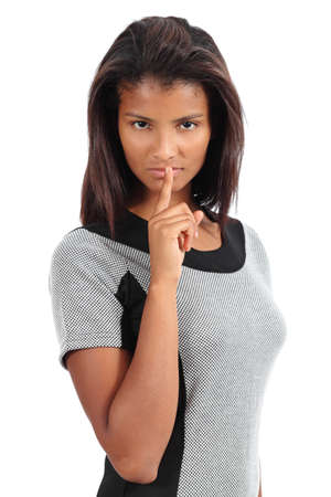 Beautiful african american woman with the finger on lips isolated on a white background photo