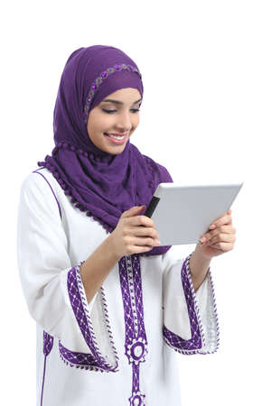 Arab woman reading a tablet reader isolated on a white background               photo