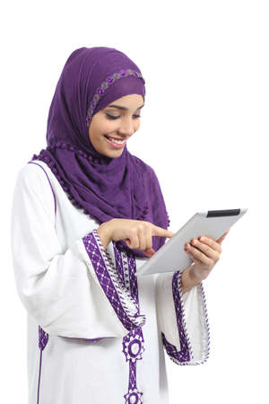 muslim girl: Arab woman reading and touching a tablet reader isolated on a white background