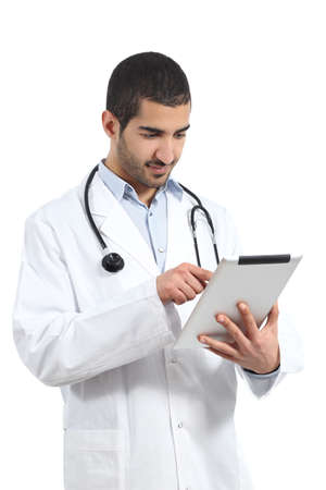 Arab saudi doctor man reading a tablet reader isolated on a white background               photo