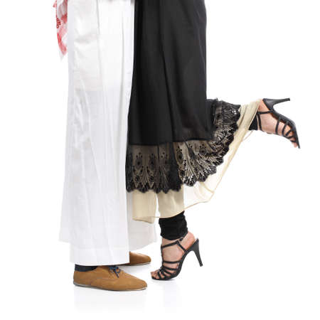 Arab saudi emirates couple legs hugging isolated on a white background            photo