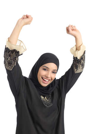 middle eastern woman: Arab saudi emirates woman euphoric raising arms isolated on a white background               Stock Photo