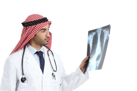 Arab saudi emirates doctor man looking a radiography diagnosing isolated on a white background       photo