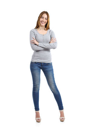 Confident full body of a casual happy woman standing wearing jeans isolated on a white background