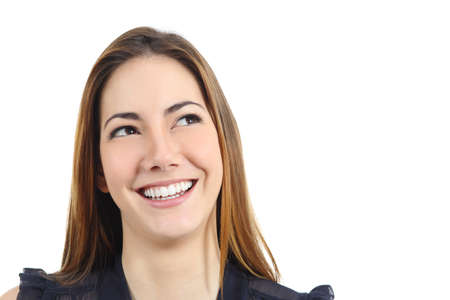 Portrait of a happy woman with perfect white smile looking sideways isolated on a white background photo