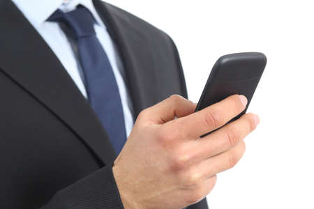 Close up of a business man hand holding and using a smart phone isolated on a white background photo