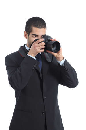 Professional photographer photographing with a digital dslr camera isolated on a white background               photo