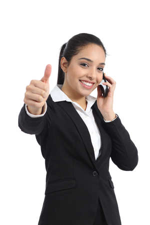 Arab business woman calling on the phone and thumb up isolated on a white background           photo