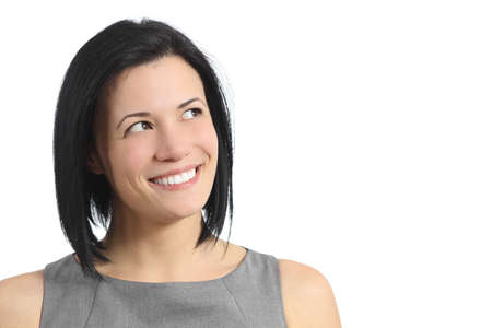 Portrait of a happy smiling woman looking sideways isolated on a white background         photo