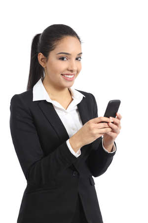 office use: Arab business woman using a smart phone and looking at camera isolated on a white background