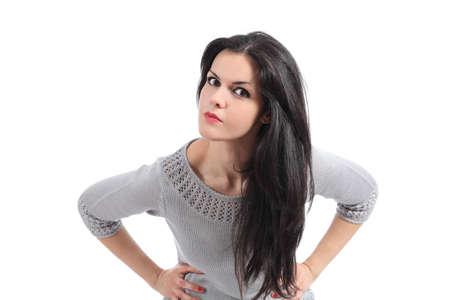 Portret van een boze vrouw kijken camera geïsoleerd op een witte achtergrond Stockfoto