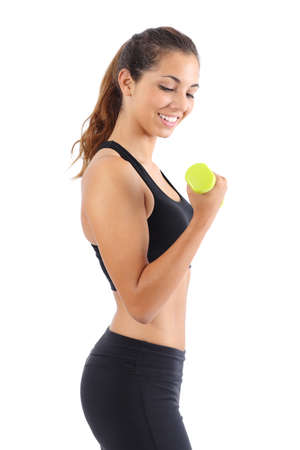 Profile of a young fitness woman doing weights exercises isolated on a white background photo