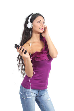 Beautiful woman listening to the music from a smart phone isolated on a white background              photo