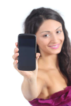 Teenager girl showing a smart phone display isolated on a white background photo