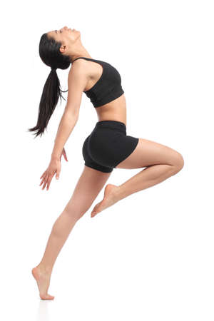 Fitness woman dancing doing aerobic exercises isolated on a white background                   photo