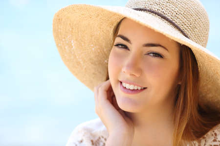 Portrait of a beautiful woman face in summer with a warmth light on the beach              photo