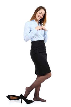 白い背景上に分離されて美しいビジネス女性ドレッシングまたは脱いでいます。 写真素材