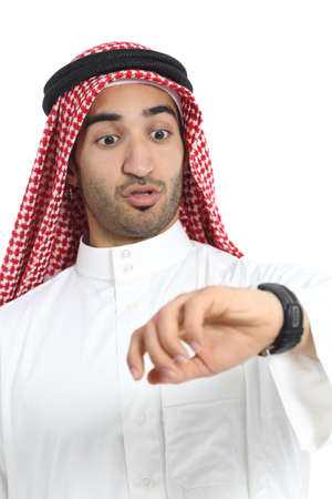 Arab saudi emirates man looking his watch too late isolated on a white background               photo