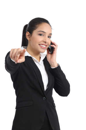 Arab business woman on the phone pointing at camera isolated on a white background              photo