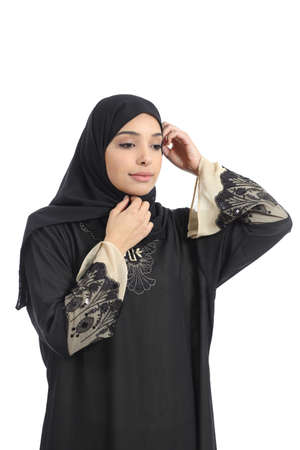 Arab saudi emirates woman dressing putting a traditional headscarf isolated on a white background photo