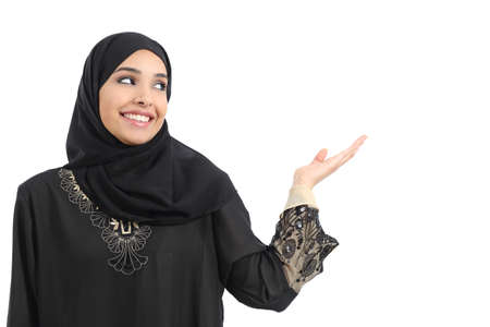 promoter: Arab saudi emirates woman promoter presenting looking at side              Stock Photo