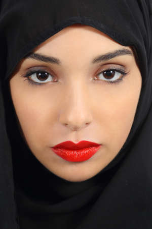 veiled: Portrait of an arab saudi emirates woman with plump red lips make up