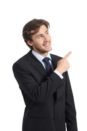 Handsome business man pointing at side presenting a product isolated on a white background   photo