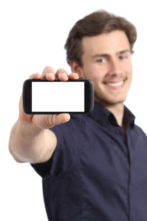 Handsome young man showing a blank smart phone display isolated on a white background          Stock Photo