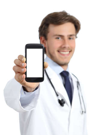 Happy doctor man showing a blank smart phone screen isolated on a white background
