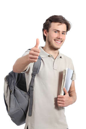 Young academical student gesturing thumb up isolated on a white background photo