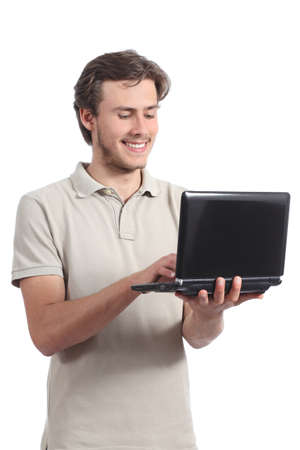 Young student boy browsing his netbook computer isolated on a white background photo