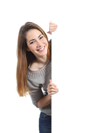holding a sign: Smiling woman presenting and holding a blank sign isolated on a white background               Stock Photo