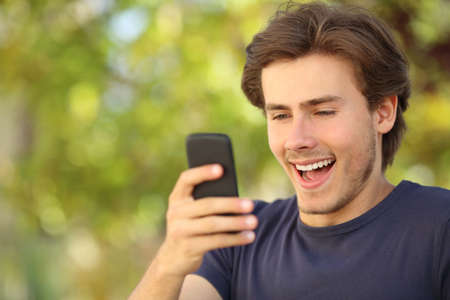 Happy man surprised looking at the smart phone Stok Fotoğraf - 28873819
