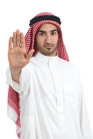 Arab saudi man gesturing stop with his hand isolated on a white background   Stock Photo
