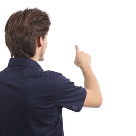 deciding: Back view of a man pushing button in the air isolated on a white background              Stock Photo