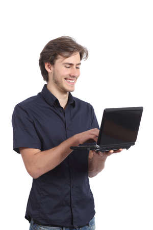 Man smiling browsing internet on the laptop isolated on a white background  photo