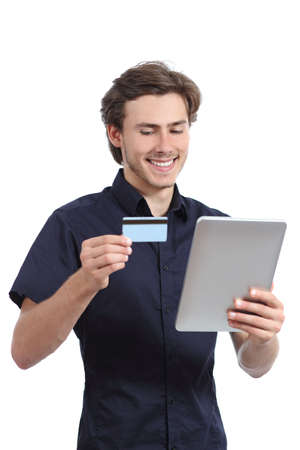 Happy man shopping with a credit card in a tablet isolated on a white background                photo