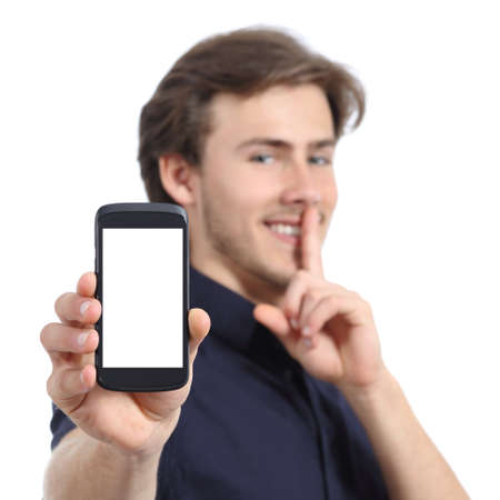 Man showing mobile phone screen and asking for silence isolated on a white background