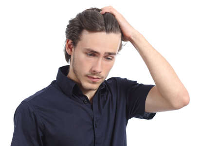 Worried depressed man with the hand on the head isolated on a white background photo