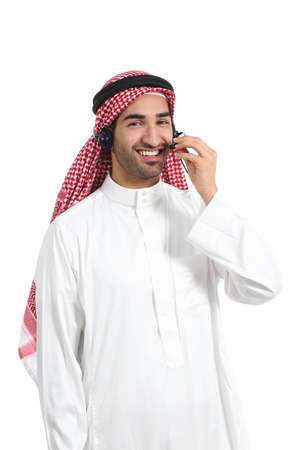 Arab saudi operator man working with free hands headset on the phone isolated on a white background                photo