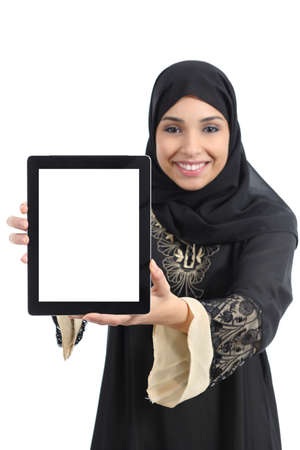 Arab saudi emirates happy woman showing an app in a tablet screen isolated on a white background   photo