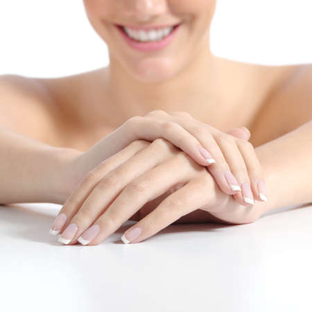 Beautiful woman hands nails with perfect french manicure isolated on a white background