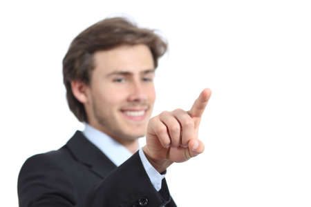 Happy businessman checking a virtual button isolated on a white background photo